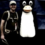 John meets Tux on the expo floor